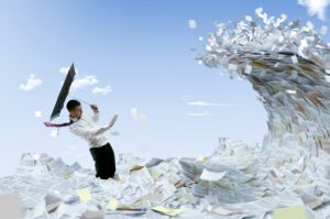 A tidal wave of paper threatens to overtake a business man