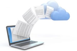 Paper flying up from a laptop and into a cloud