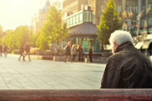 Older person sitting on a bench