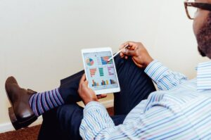 Man with tablet with charts and graphs