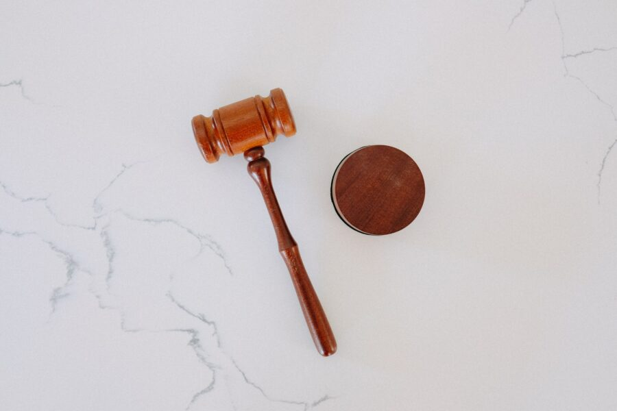 Wooden judicial gavel on marble table
